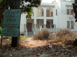 "Even in Cairo, where the real estate market has been booming, families are walking away from their homes. The sign in front of this one, says Our Man in Cairo, Joseph Mayton, reads ""not for sale."""