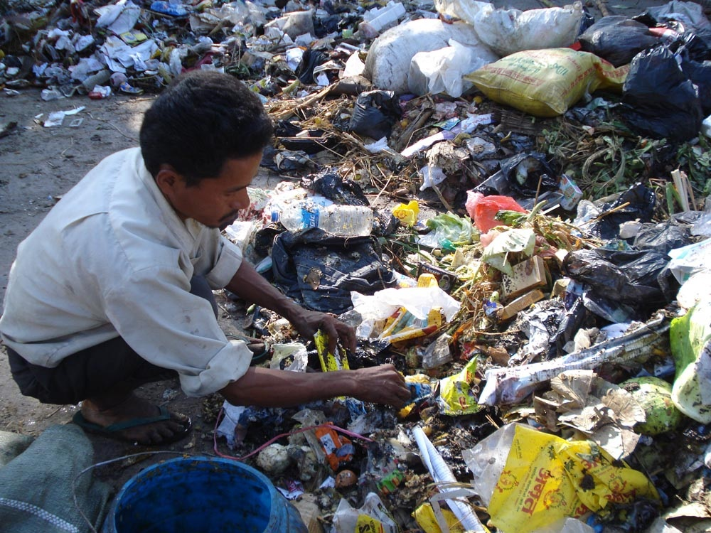"Bhandari asked this man how long he had been ""recycling,"" but the man refused to answer."