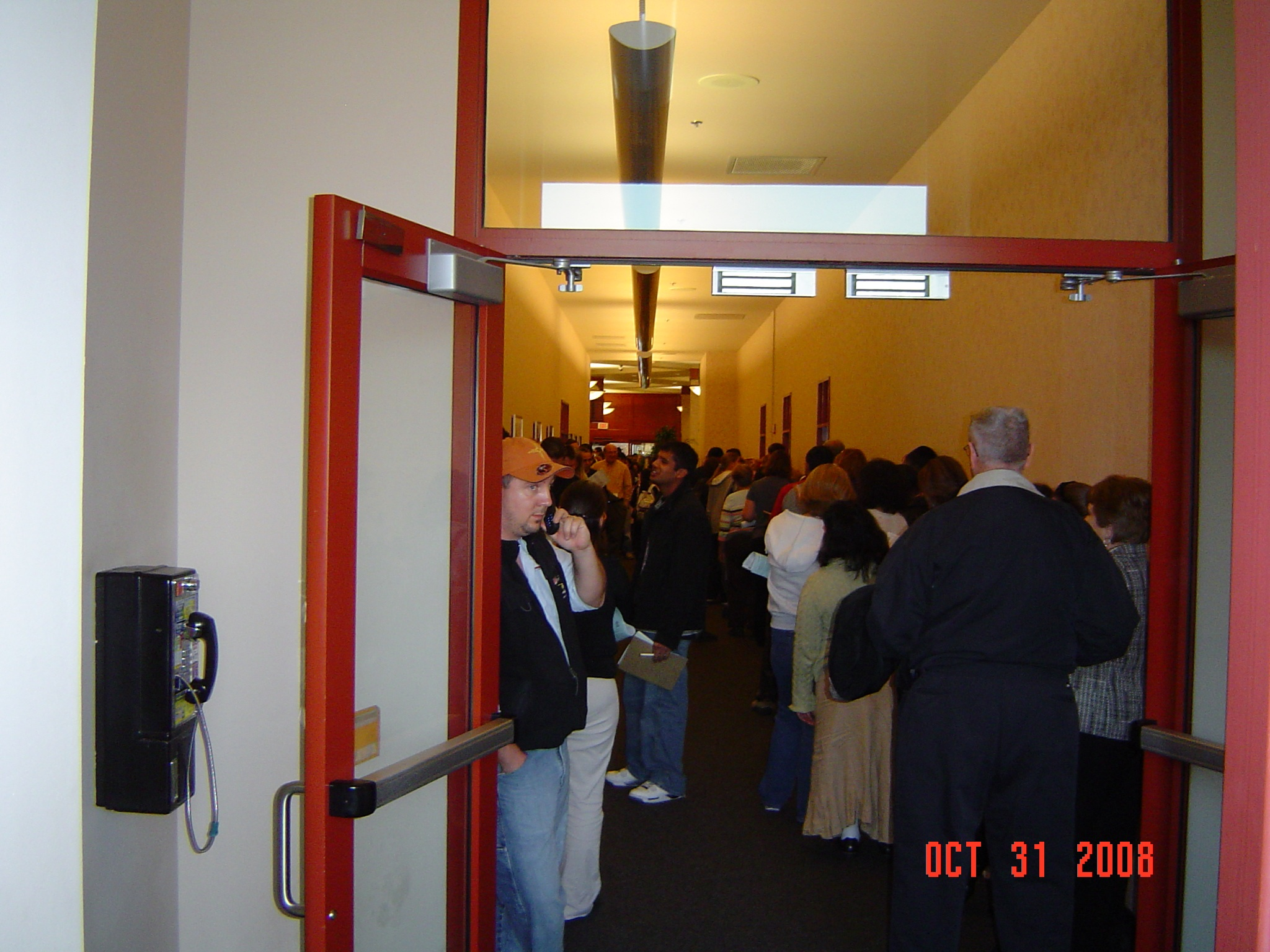 Schaumburg Township District Library's line of Cook County early voters after poll hours elapsed on Thursday, the final day for early voting in Illinois. Some people waited up to two hours after polls closed at this location to cast their ballots.